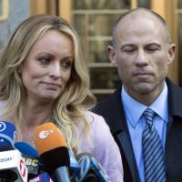 Adult film actress Stormy Daniels speaks outside a federal court in New York on April 16. Beside her is her lawyer Michael Avenatti. | AP