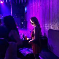 Stormy Daniels holds a meet-and-greet with patrons during her appearance at the strip club Gossip on Saturday in Melville, New York. | AP