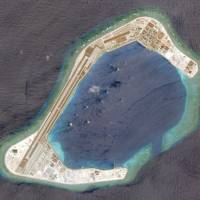 This satellite photo shows Subi Reef on March 20. | REUTERS