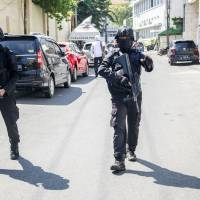 Indonesia suicide bombings work of two families, police say