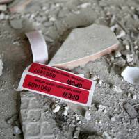Labels of the Organisation for the Prohibition of Chemical Weapons (OPCW) are seen inside a damaged house in Douma, near Damascus, on April 23. | REUTERS