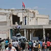 Syrian military takes key territory in country's center, says 'armed terrorism has been uprooted'