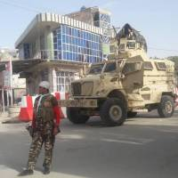 Well-armed Taliban battle into west Afghan city in new crisis for Kabul regime despite U.S. air support
