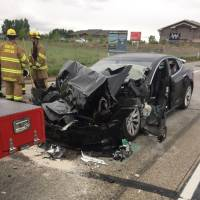 Tesla with Autopilot feature slams into truck stopped at red light