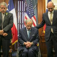 Texas Gov. Greg Abbott prays during a discussion about guns in schools at the Governor's Reception Room at the Capitol in Austin, Texas, Thursday. Abbott wrapped up three days of emotional meetings on school safety and mass shootings Thursday by speaking with survivors from last week's mass shooting at a high school near Houston. But there's little expectation that the staunch gun-rights supporter will push for major changes. | JAY JANNER / AUSTIN AMERICAN-STATESMAN / VIA AP