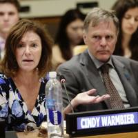 Fred Warmbier listens as his wife, Cindy Warmbier, speaks of their son, Otto Warmbier, an American who died last year, days after his release from captivity in North Korea, during a meeting Thursday at the United Nations headquarters. | AP