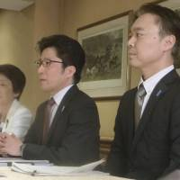 Family members of Japanese abductees meet with senior officials of a U.S. human rights group in Washington on Wednesday. Center: Takuya Yokota, whose sister, Megumi, was abducted by North Korean agents in 1977 at age 13. | KYODO