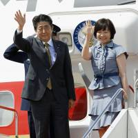 Abe expresses hope for peace treaty progress as he departs for summit with Putin