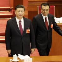 Chinese President Xi Jinping and Premier Li Keqiang, shown at the National People's Congress in Beijing on March 5, will X when they X next week.   BLOOMBERG