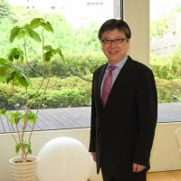 Tomoyoshi Noda, who is opening a business school in Tokyo in August, poses for a photo April 25. | SATOKO KAWASAKI