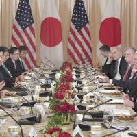 Prime Minister Shinzo Abe and U.S. President Donald Trump hold talks in Florida in April. The annual Diplomatic Bluebook released Tuesday stresses the importance of the U.S.-Japan alliance against North Korean threat. | KYODO