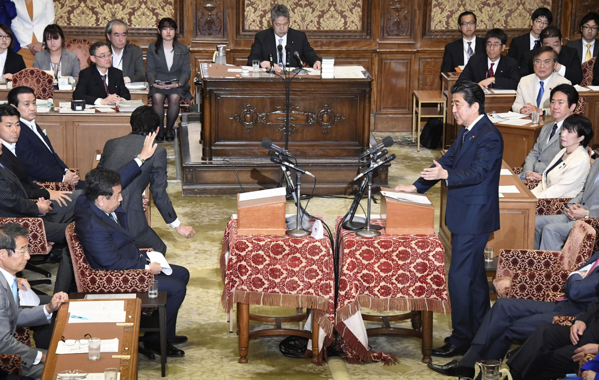 Prime Minister Shinzo Abe takes a question from Yukio Edano, head of the Constitutional Democratic Party of Japan, during a party leaders' debate on Wednesday in the Diet.  | KYODO