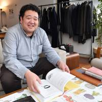 Kazuma Kawagoe, president of CoCooking Co., is seen at his office in Tokyo. He founded Tabete, a food waste reduction system, in hopes of raising awareness of the issue of food loss in Japan. | YOSHIAKI MIURA