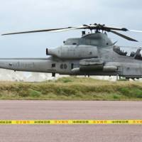 A photo taken in January by a resident of the village of Tonaki, Okinawa Prefecture, shows a U.S. military AH-1 attack helicopter at a heliport on Tonaki Island. | KYODO