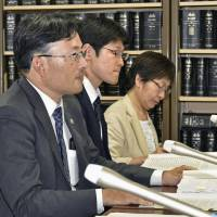 Kazushi Kubota, a lawyer representing a plaintiff suing the city of Saitama over its refusal to publish a pacifist haiku in a newsletter, holds a news conference in Tokyo's Kasumigaseki district on Friday following a ruling by the Tokyo High Court. | KYODO