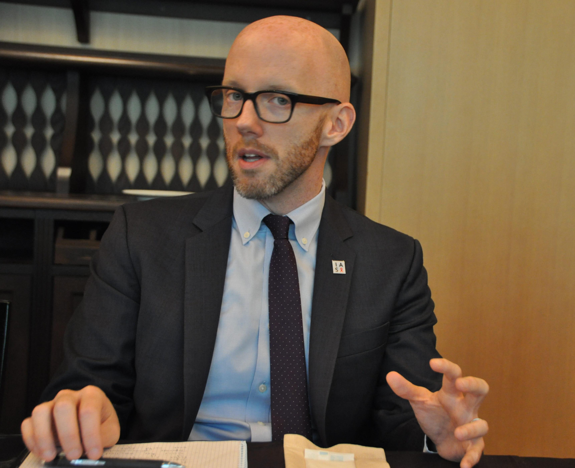 Owen Ryan, executive director of the International AIDS Society, speaks during a group interview in Tokyo on April 25. | KYODO