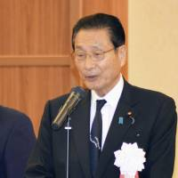 Kanji Kato, a ruling Liberal Democratic Party lawmaker who was criticized over his remark urging newlyweds to have at least have three children, speaks during a party meeting in Nagasaki on Sunday. | KYODO