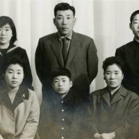 A portrait shows (clockwise from left) Kang Yeoung Suk, her father, brother, mother, and her youngest brother, and sister who moved to North Korea in the 1970s. | COURTESY OF KANG YEOUNG SUK