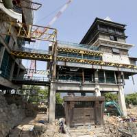 The removal of the stone foundation of a tower at Kumamoto Castle made it look as if it was floating in the air when it was shown to the media on Tuesday.   KYODO