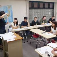 Students from overseas attend a lesson at a Japanese language school in Tokyo's Taito Ward in June 2016. A cross-party association of lawmakers unveiled a draft bill Tuesday that would oblige the government to systematically promote Japanese education for non-Japanese both at home and abroad. | KYODO