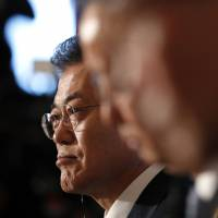 South Korea's President Moon Jae-in attends a trilateral summit with Prime Minister Shinzo Abe and Chinese Premier Li Keqiang at Akasaka Palace in Tokyo on Wednesday. | AP