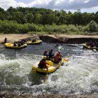 Tourists take part in a rafting tour in the town of Kutchan, Hokkaido, in 2016. | BLOOMBERG