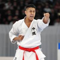 There are growing expectations for Okinawa natives such as Ryo Kiyuna, pictured, who won his sixth-straight men's 'kata' national championship in December, to seize gold in the 2020 Tokyo Olympics. | THE OKINAWA TIMES