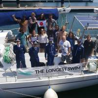 The expedition crew for Ben Lecomte assemble at Yokohama Bayside Marina ahead of his departure from Choshi, Chiba Prefecture, on Tuesday.  | Courtesy of The Longest Swim