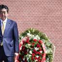 Prime Minister Shinzo Abe attends a wreath-laying ceremony at the Tomb of the Unknown Soldier in Moscow on Saturday. Japanese officials said Sunday Japan will maintain maximum pressure in a bid to get North Korea to abandon its nuclear and missile programs.