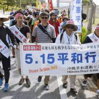 Okinawa protesters march against plan for U.S. base ahead of anniversary of prefecture's reversion to Japan