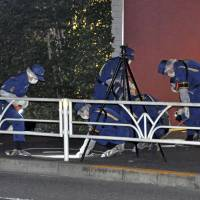 Authorities investigate the scene of a stabbing outside NHK headquarters in Tokyo's Shibuya Ward on May 18. | KYODO