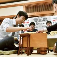 Shogi whiz Fujii becomes youngest promoted to seventh dan