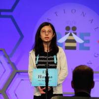 Hanna Yoshida, a student at K. International School Tokyo and the winner of this year's Japan Times Bee, competes during the preliminary round of the U.S. National Spelling Bee in National Harbor, Maryland, on Tuesday. | KYODO