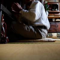 A 75-year-old man, who goes by the name Saburo Kita in the Japanese media to avoid questions from his late wife's family, is interviewed at his home in Tokyo on April 22. | REUTERS