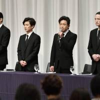 Shigeru Joshima (second from right), leader of the Japanese all-male pop group Tokio, speaks at a news conference Wednesday in Tokyo while other group members Masahiro Matsuoka, Tomoya Nagase and Taichi Kokubun look on. | KYODO