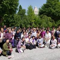 Supporters of a bill seeking to achieve 50-50 gender equality in the Diet and local assemblies pose for a photo in front of the Diet building on Wednesday following enactment of the legislation. | TOMOHIRO OSAKI
