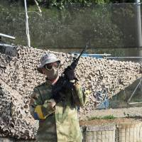 A man takes part in a game of airsoft at  Tokyo Sabage Park in Inzai, Chiba Prefecture, in March. | MARK THOMPSON