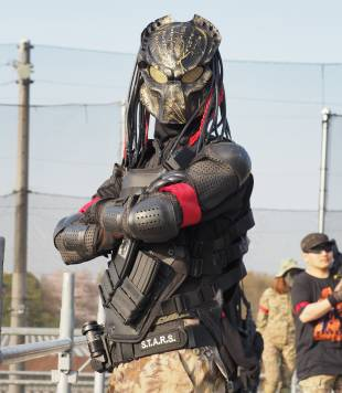 Kei, a carpenter from Yokohama, takes part in an airsoft game at Tokyo Sabage Park in China Prefecture wearing body armor and a mask of the alien warrior character from the movie