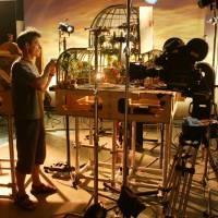 Locale setup: A greenhouse set from 'Wallace and Gromit: Curse of the Were-Rabbit' gets a touchup before filming starts. | COURTESY OF TRISTAN OLIVER