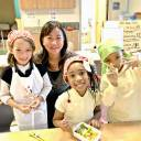 Food fanatics: Mayumi Uejima-Carr (center), with her daughter (left) at a Table for Two Wa-Shokuiku class, which teaches kids about  healthy eating using elements of Japanese food culture.