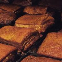Pig out: Pork belly being barbecued in Bashamichi Taproom's smoker. The smoker is fuelled by locally sourced cherry wood, which gives the meat a sweet, smoky flavor.   JEREMY WILGUS