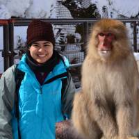 Primatologist Rafaela Takeshita and a Japanese macaque pose for the camera. | COURTESY OF RAFAELA TAKESHITA