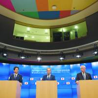 Prime Minister Shinzo Abe (left), European Council President Donald Tusk (center) and President of the European Commission Jean-Claude Juncker address the media on the occasion of the European Union-Japan Summit in Brussels on July 6. | EUROPEAN UNIONE