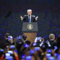 U.S. President Donald Trump speaks at the APEC CEO Summit, part of the broader APEC leaders' summit, in Danang, Vietnam, on Nov. 10, laying out his broad vision for preserving peace and prosperity across the Indo-Pacific region. | AP