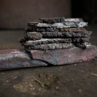 Pieces of tamahagane raw steel are first forged into thin plates, which in turn are broken into pieces and stacked together for strength. | CHRISTINA SJOGREN
