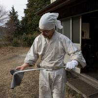 Yasha Yukawa checks his handiwork at his forge in the valleys around Hofu in Yamaguchi Prefecture. | CHRISTINA SJOGREN