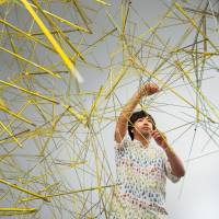 Kengo Kito will install 'Broken Flowers,' a huge colorful textile waterfall covering the main entrance of The National Art Center, Tokyo. | FUTOSHI OHKI