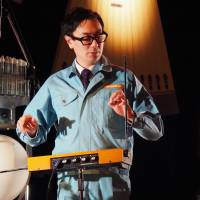 Sound artist and designer Yuri Suzuki, a visiting member of Maywa Denki plays the theremin for the art unit's 25th anniversary concert in Tokyo. | MIO YAMADA