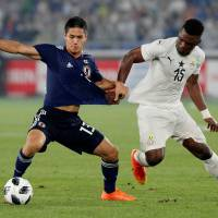Japan's Yoshinori Muto (left) and Ghana's Rashid Sumaila battle for position in Wednesday's international friendly at Nissan Stadium. Ghana won 2-0.    REUTERS