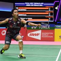 Kento Momota hits a return against Brice Leverdez of France in a men's singles quarterfinals match at the Thomas Cup in Bangkok on Thursday. | AFP-JIJI